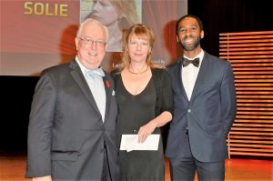 William Hewitt and Ian Williams present the Latner Writers' Trust Prize to Karen Solie. 2015.